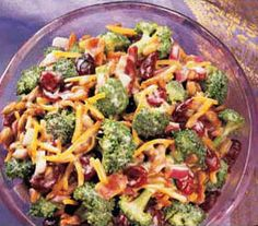Craisin Broccoli Salad ~One of my FAVORITE cold salads and so easy to make. This looks similar to the recipe I use, but I use plain old vinegar and find it turns out fabulous!