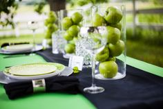 GREEN APPLES Super great and simple Halloween table design in black, white, & lime green. Love the apples.     Source: frostedpetticoatblog.com
