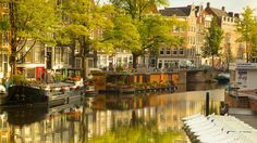 Amsterdam - The Netherlands - Houseboats on the canal.