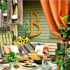 small patio with shades of orange, brown, tan, and green