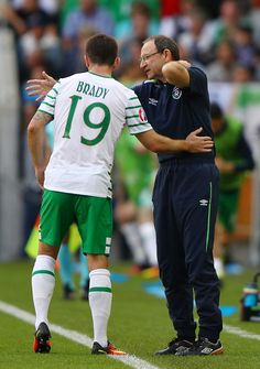 Martin O'Neill manager of Republic of Ireland speaks to Robbie Brady of Republic of Ireland during the UEFA EURO 2016 Group E match between Belgium...