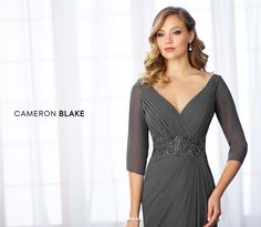mon cheri bridals 217641 - Sleeveless chiffon slim A-line gown with front and back V-necklines, directionally pleated bodice with hand-beaded wide natural waistband, side draped skirt with cascading ruffle, sweep train. Additional illusion three-quarter length sleeves and matching shawl included.
