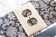 Fabric cover your outlet cover. Mod podge is so multi purpose :)