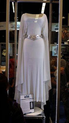 Prince'ss Leia's Ceremonial Gown, worn at the end of Star Wars Episode IV: A New Hope. This costume has actually been MIA for many years, and was finally located in a private collection, restored of damages, and brought to Star Wars Celebration 2015 for display.
