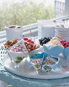 Sundae Party - Celebrate summer with a colorful sundae party; set out toppings in fortune-tellers, those folded-paper staples of childhood.