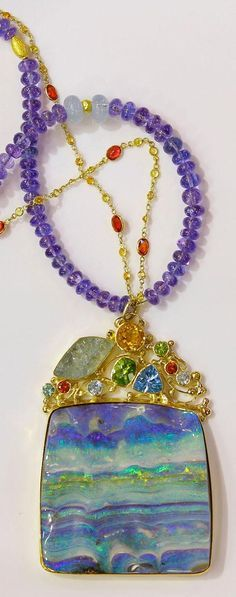 Australian boulder opal w/ rough Aquamarine, Peridot, Trillion Topaz, orange garnet hanging from tanzanite beads and orange sapphire chain. http://www.kalledjewelrystudio.com/collections/jennifer-kalled/products/boulder-opal-pendant