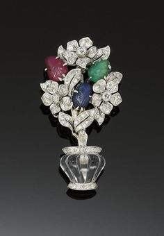 Rock crystal, diamond, carved ruby, sapphire and emerald leaves brooch. 1930 Christie's (500£)