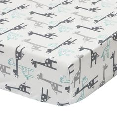 The Peanut Shell Uptown Giraffe fitted crib sheet is made from soft 100-percent cotton sateen and features a contemporary giraffe print in grey and mint. Coordinates perfectly with the Peanut Shell Uptown Giraffe nursery collection.
