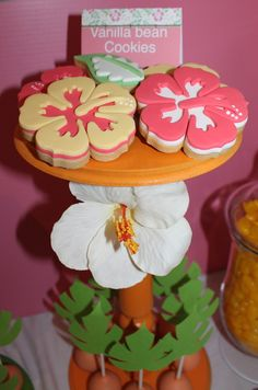 Hibiscus vanilla bean cookies at a Hawaiian Luau Party  . . . love the cake pops on the bottom!
