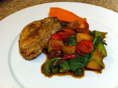 Pork chop with peach, tomatoes, roasted chilli, apple juice, and spinach