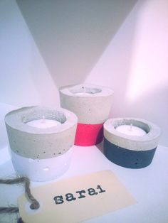 This fun neon pink, charcoal and white concrete candle set will brighten up any space.