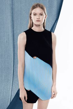 - GARMENT 2 -  Dion Lee, Resort 2015  This dress has a blue section, detailed as waves. This looks like the ocean and the tides in the water. Also the color of it has a shine to it adding to the detailing that goes with this trend.