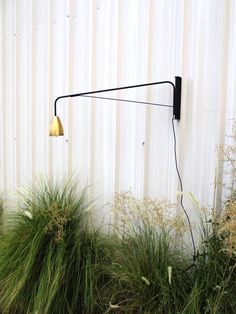 Black swiveling wall lamp with brass shade by OneFortyThree