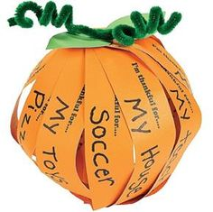 Love this idea. It's a thankful pumpkin where kids write down what they are thankful for and then configure the orange strips of paper into a pumpkin. This is a great way to celebrate Thanksgiving with your little one.
