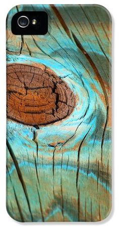 A painted (orange and sky blue) but extremely weathered piece of wood, complete with knot, from an ocean boardwalk makes a very original iphone cover! An original photo by Kristen N. Fox. http://pixels.com/products/topographical-knot-photograph-kristen-fox-iphone5-case-cover.html