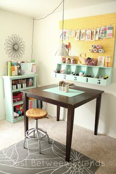 Love that bright yellow pegboard for a craft room | Just Between Friends. I love the darn shelf(?) thing with the numbers on it! ♡
