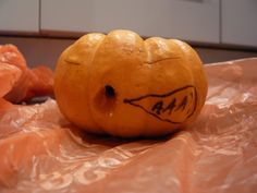 Big pumpkin eating a small one