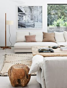 ~ Interior design project by BATAVIA #neutral #home #living #room white walls + white floors + tan pillow accents + wood tones -  ♥