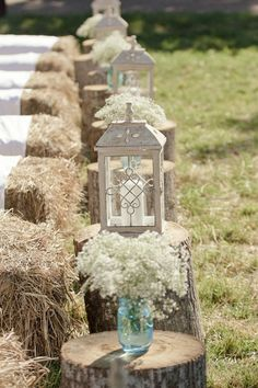 Hay bale seating with covers. Lanterns, baby's breath in mason jars and tree stumps for the aisles | Deer Pearl Flowers