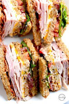 Club Sandwich (Turkey, Ham, Bacon) A club sandwich is a delicious deli classic, and it is so easy to make yourself at home. Club Sandwich (T. Subway Sandwich, Sandwich Bar, Healthy Recipe Videos, Healthy Dinner Recipes, Healthy Snacks, Cooking Recipes, Bacon Recipes, Delicious Recipes, Turkey Ham