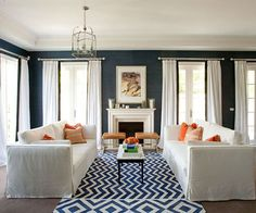 Navy grasscloth, wide crown molding, ceiling to floor curtains... LOVE the color palette