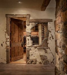 Spectacular alpine ranch house with rustic-modern details in Montana Wine Cellar Basement, Home Wine Cellars, Break Wall, Wine Cellar Design, Rustic Doors, Rustic Walls, Rustic Design, Eclectic Design, Modern Rustic