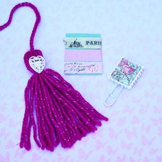 A gorgeous dark pink and vintage themed kit consisting of a vintage stamp paper clip, a beautiful dark ping tassel with a white heart
