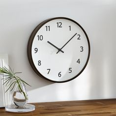 "Shop Lorne 12"" Wall Clock. A recessed face floats within a wrap of warm-toned wood in this handsome wall clock. Great for the office or bedroom, its casual look features large, easy-to-read numbers and clean-lined hands."