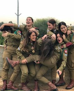 25 images of the hottest Israeli Defense Forces women who look just a good in fatigues as they do in bikinis! 1 Use the navigation to continue with the article. Idf Women, Military Women, Mädchen In Uniform, Army Police, Military Girl, Female Soldier, Warrior Girl, Girls Uniforms, Armed Forces