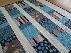 Love the colors for a boy baby quilt. Uses charm squares, seems simple enough for me.