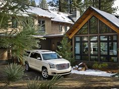 Even in the snow, the temperature-controlled garage keeps vehicles ready to venture out.- Front Yard Pictures From HGTV Dream Home 2014 on HGTV