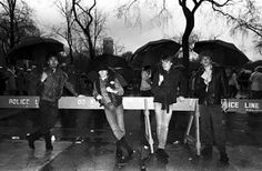 U2 carry their own umbrellas...... NYC early 1980s.