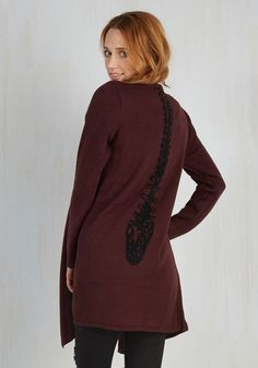 This burgundy sweater is a look you can own! With a drapey, open front and a black spine knit down its back, this comfy cardigan is yours for the styling.