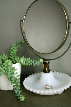 Vintage milk glass mirror..what I would give to run across one like this!