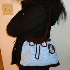 """Handmade Crocheted Baby Blue & Brown Tote Bag This is a beautiful crocheted tote/shoulder style bag handmade by me.  I crocheted this bag using a tight crocheted stitch. * Material: 100% Acrylic Yarn * Measurements. Approximately. 12"""" L x 9"""" H * Handles Approximately. 24"""" * Handle Drop Approximately  9"""" * This bag was handmade with love & comes from a smoke & pet free home. * Made in The USA * More handmade bags by me coming soon! :-) Bags Totes"""