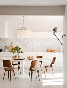 Don't like either of the light fixtures, but everything else is perfection. Is that a poured resin floor? By ML-H Design.