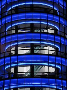 """""""Blue Neon"""" - photo by Rian Long [rianklong), via Flickr;  """"Neon rings a tubular structure that houses escalators at the Pacific Design Center office building [in West Hollywood, California]. The neon alternates between blue, purple, green, yellow, and red with a few different intensities of each color."""""""