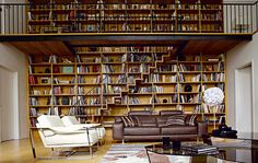 now slowly get your chin off the floor. gorgeous bookshelves / staircase / statement wall