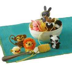 Use a fork to make a family of fuzzy pompom critters.
