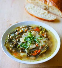"I have been trying to eat more ""super foods"" lately and one vegetable I never think to buy is kale. Kale reminds me a lot of spinach when it's cooked so I thought a hearty Italian soup with kale would fit together nicely. This recipe is a peasant style soup with white beans, potatoes, veggies, and"