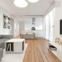 Biel przełamana jasnym drewnem. Whites contrasted with light wood.