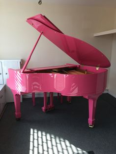 Pink Nieser Baby Grand piano finished in high gloss polyester. www.chilternpianos.co.uk