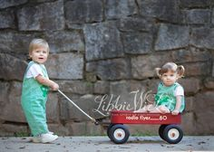 one year old twins with a wagon