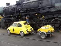 1967 Fiat 500 Nuova and Fiat Puppy meet Giant Black, the Steam Engine. Seen at the VSM depot Beekbergen.