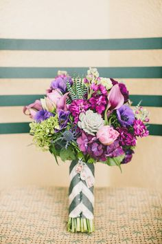 Whimsical Purple Wedding Bouquet | Photography: Wai Reyes Photo | Floral Design: Flower Allie | See More: http://stylemepretty.com/2013/06/28/newport-coast-wedding-from-wai-reyes-photography