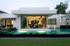 Home Design Exterior Architecture. Contemporary White T Shaped House Design Ideas Come With Black Marble Deck Outdoor Pool And Open Plan Interior Living Space With Sliding Doors.
