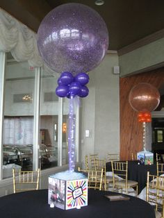 photo cube as a base very clever way to show the sponsors Travel Photo Cube & Sparkling Balloon Centerpiece