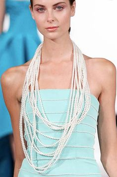 Pearls layered over a pearl-embroidered gown at Oscar de la Renta, Spring 2014