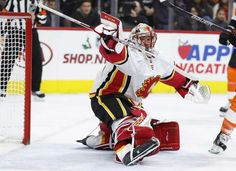 Calgary Flames' Mike Smith looks on after making the save during the second period of an NHL hockey game against the Philadelphia Flyers, Saturday, Nov. 18, 2017, in Philadelphia. (AP Photo/Chris Szagola)