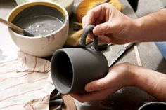 Heath Ceramics, attaching a handle. To learn more about Heath's history, and current role as a leading dinnerware manufacturer in the US, check out the March 2015 issue of Ceramics Monthly. http://ceramicartsdaily.org/ceramics-monthly/ceramics-monthly-march-2015/
